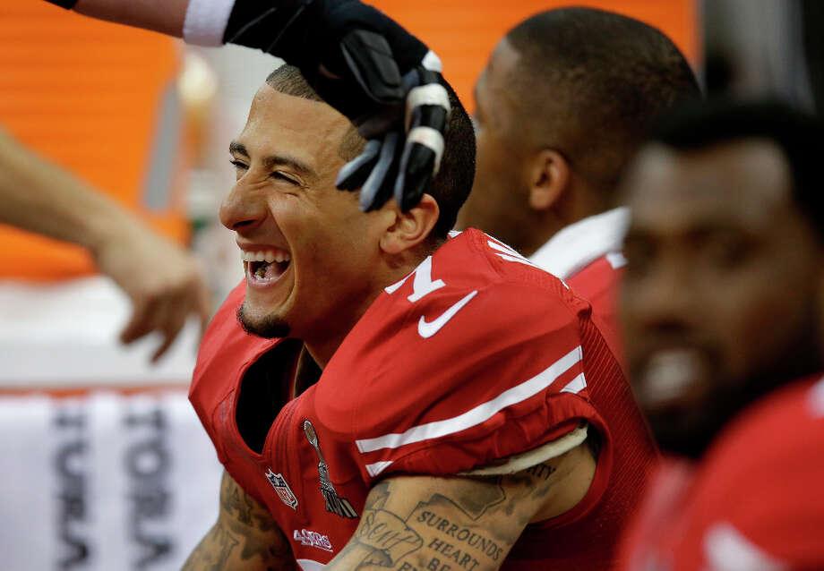 San Francisco 49ers quarterback Colin Kaepernick laughs before the Super Bowl. Photo: Evan Vucci