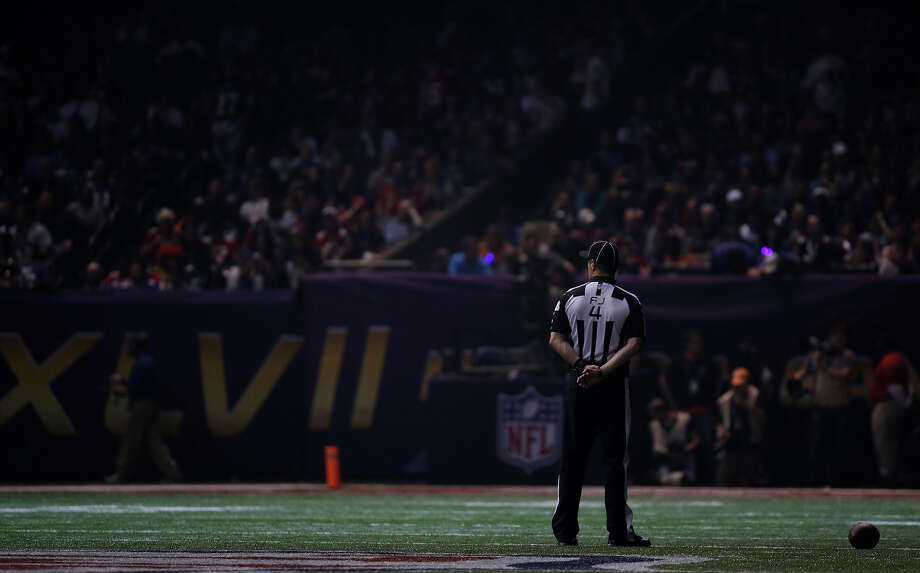 Field judge Craig Wrolstad stands on the field after the lights went out during the second half of NFL Super Bowl XLVII football game Sunday, Feb. 3, 2013, in New Orleans. (AP Photo/Matt Slocum) Photo: Matt Slocum, ASSOCIATED PRESS / AP2013