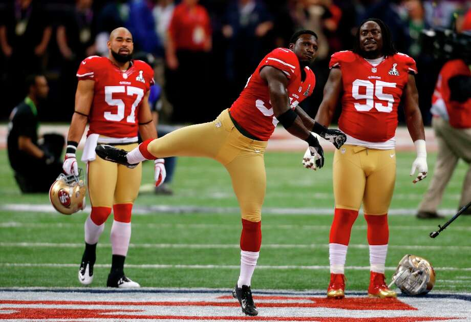 Linebacker Tavares Gooden (56) stretches with Linebacker Michael Wilhoite (57) and Defensive tackle Ricky Jean Francois (95) before Superbowl XLVII between the San Francisco 49ers and the Baltimore Ravens at the Mercedes-Benz Superdome on Sunday February 3, 2013 in New Orleans, La. Photo: Carlos Avila Gonzalez, The Chronicle / ONLINE_YES