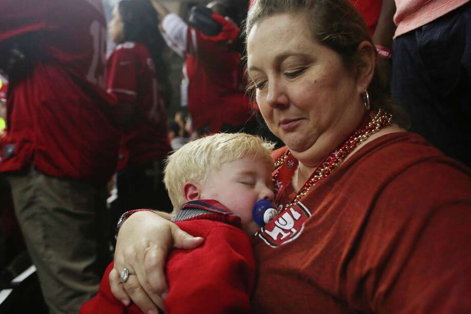 Nanny Shelly Buller holds sleeping Hudson Smith, 20 months, son of Niners Alex Smith during first quarter at Superbowl XLVII between the San Francisco 49ers and the Baltimore Ravens at the Mercedes-Benz Superdome on Sunday February 3, 2013, New Orleans, La. Photo: Mike Kepka, The Chronicle / ONLINE_YES