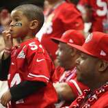 Isaiah Grant, 4, son of Niners Larry Grant, watches during the first quarter of Superbowl XLVII between the San Francisco 49ers and the Baltimore Ravens at the Mercedes-Benz Superdome on Sunday February 3, 2013, New Orleans, La.