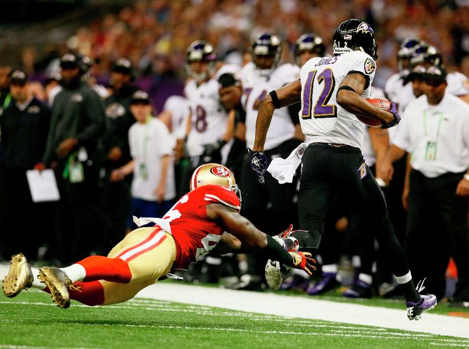 Baltimore Ravens wide receiver Jacoby Jones (12) catches a long pass through the attempted tackle of tight end Delanie Walker (46) in the first half of Superbowl XLVII between the San Francisco 49ers and the Baltimore Ravens at the Mercedes-Benz Superdome on Sunday February 3, 2013 in New Orleans, La. Photo: Michael Macor, The Chronicle / SFC