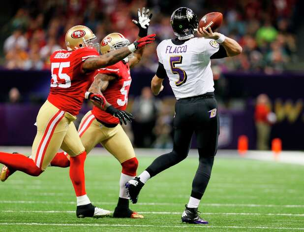 Baltimore Ravens quarterback Joe Flacco (5)  throughs through an attempted block in the first half of Superbowl XLVII between the San Francisco 49ers and the Baltimore Ravens at the Mercedes-Benz Superdome on Sunday February 3, 2013 in New Orleans, La. Photo: Michael Macor, The Chronicle / SFC