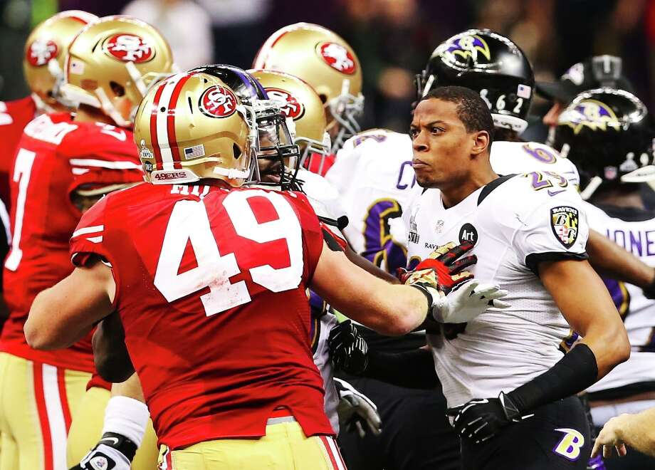 NEW ORLEANS, LA - FEBRUARY 03:  (L-R) Bruce Miller #49 of the San Francisco 49ers and Cary Williams #29 of the Baltimore Ravens exchange words in the first half during Super Bowl XLVII at the Mercedes-Benz Superdome on February 3, 2013 in New Orleans, Louisiana. Photo: Ronald Martinez, Getty Images / 2013 Getty Images
