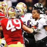 NEW ORLEANS, LA - FEBRUARY 03:  (L-R) Bruce Miller #49 of the San Francisco 49ers and Cary Williams #29 of the Baltimore Ravens exchange words in the first half during Super Bowl XLVII at the Mercedes-Benz Superdome on February 3, 2013 in New Orleans, Louisiana.