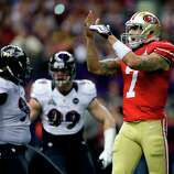 San Francisco 49ers quarterback Colin Kaepernick (7) calls a timeout during the first half of the NFL Super Bowl XLVII football game against the Baltimore Ravens, Sunday, Feb. 3, 2013, in New Orleans. (AP Photo/Evan Vucci)