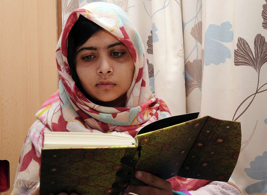FILE - In this undated file photo provided by Queen Elizabeth Hospital in Birmingham, England, Malala Yousufzai, the 15-year-old girl who was shot at close range in the head by a Taliban gunman in Pakistan, reads a book as she continues her recovery at the hospital. The Pakistani schoolgirl who was shot in the head by the Taliban is in stable condition after undergoing two successful operations to reconstruct her skull and restore her hearing, the British hospital treating her said Sunday.  (AP Photo/Queen Elizabeth Hospital, File) Photo: Uncredited