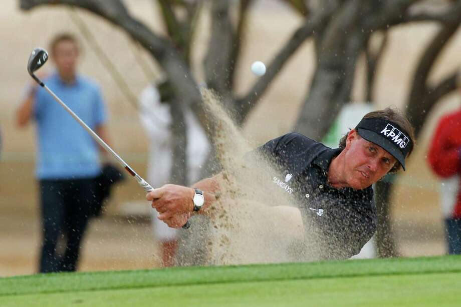 Phil Mickelson found more trouble Sunday than in the previous three rounds, but his lead was never seriously threatened. Photo: Hunter Martin, Stringer / 2013 Getty Images