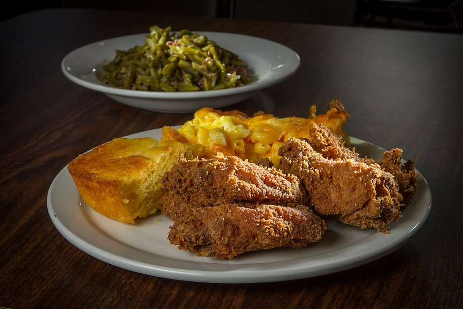 Fried chicken, corn bread and great sides like mac and cheese and green beans with smoked turkey, above, stand out at Chicken Diva, a pop-up restaurant inside Jackson Cafe in San Rafael. Chef-owner Rachel Griffin serves up mac and cheese, right. Photo: John Storey