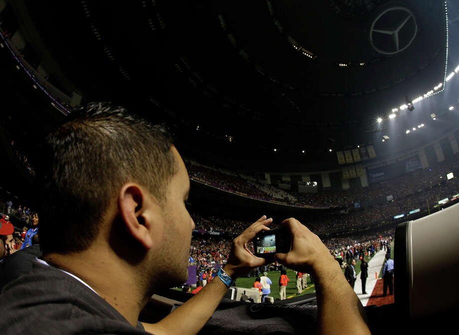 A fan takes pictures of the Superdome after the lights went out during the second half of NFL Super Bowl XLVII football game Beyonce performs during the halftime show of Sunday, Feb. 3, 2013, in New Orleans.  (AP Photo/Gene Puskar) Photo: Gene Puskar, ASSOCIATED PRESS / AP2013