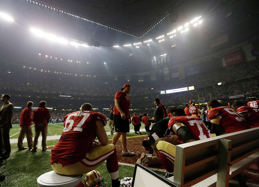 San Francisco 49ers offensive lineman Daniel Kilgore (67) waits on the bench during a power outage d