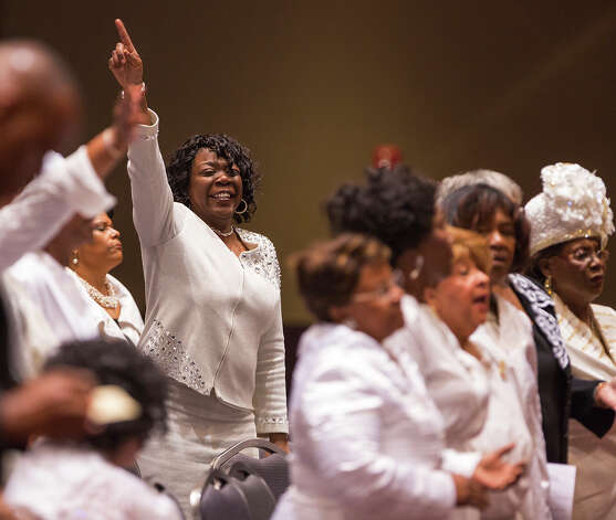 Members of the Childress Memorial Church of God in Christ rejoice during a service at the Convention Center on Sunday. The church burned to the ground last week, so services are being held at the Convention Center. Photo: Michael Miller, For The Express-News / San Antonio Express-News