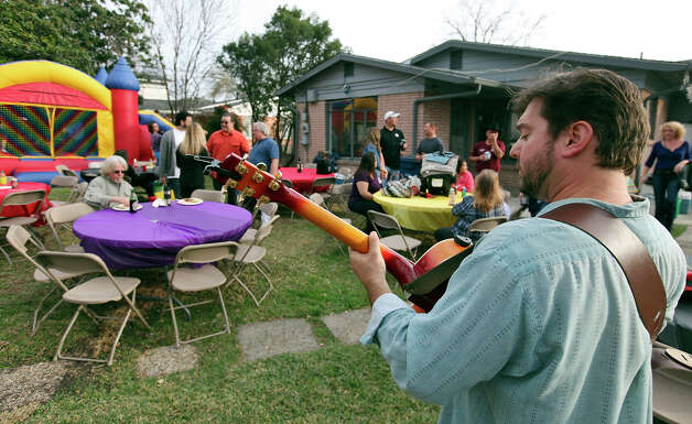 Austin Forrest performs at Billy and Shana Neel's Super Bowl party Sunday. The Neels used the party to raise money and food items for the San Antonio food Bank. Photo: Edward A. Ornelas, San Antonio Express-News / © 2013 San Antonio Express-News