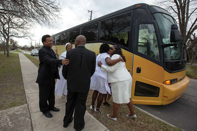 William Watson (from left), Patricia Palmer, Drexal Forbes, Tia Forbes and Dawn Sance greet each other as they board a bus headed for the Convention Center near the remains of the Childress Memorial Church of God in Christ at 901 N. Pine Street on Sunday, Feb. 3, 2013. Photo: Michael Miller, For The Express-News / For the Express-News