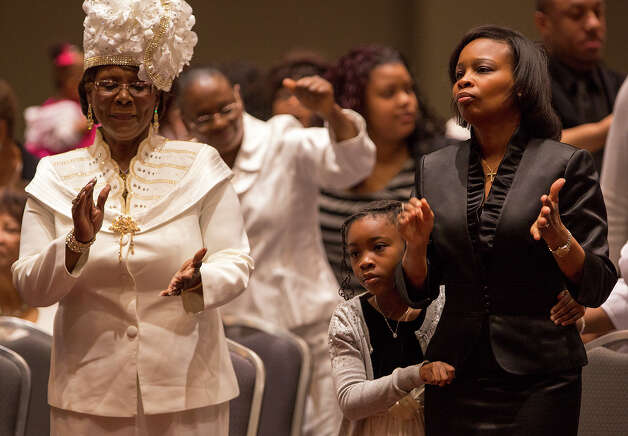 Ivy Taylor, right, and her daughter, Morgan, 9, participate in services with Childress Memorial Church of God in Christ at the Gonzalez Convention Center on Sunday, Feb. 3, 2013. Photo: Michael Miller, For The Express-News / For the Express-News