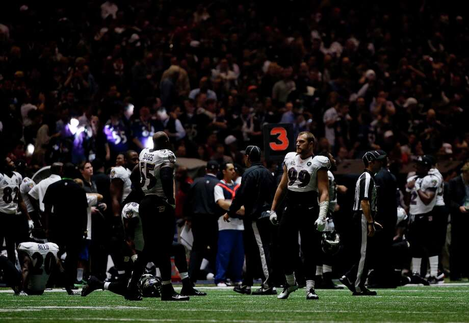 Baltimore Ravens players look around the Superdome after the lights went out during the second half of NFL Super Bowl XLVII football game Sunday, Feb. 3, 2013, in New Orleans. (AP Photo/Matt Slocum) Photo: Matt Slocum, Associated Press / AP