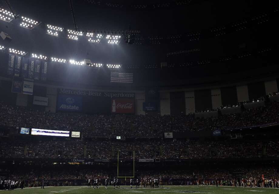 Half the lights are out in the Superdome during a power outage in the second half of the NFL Super Bowl XLVII football game between the San Francisco 49ers and Baltimore Ravens on Sunday, Feb. 3, 2013, in New Orleans. (AP Photo/Marcio Sanchez) Photo: Marcio Sanchez, Associated Press / AP