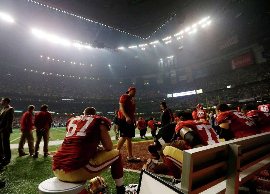 San Francisco 49ers offensive lineman Daniel Kilgore (67) waits on the bench during a power outage during the second half of the NFL Super Bowl XLVII football game Sunday, Feb. 3, 2013, in New Orleans. (AP Photo/Darron Cummings) Photo: Darron Cummings, Associated Press / AP