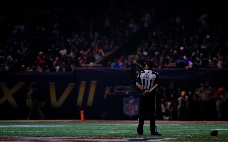 Field judge Craig Wrolstad stands on the field after the lights went out during the second half of NFL Super Bowl XLVII football game Sunday, Feb. 3, 2013, in New Orleans. (AP Photo/Matt Slocum) Photo: Matt Slocum, Associated Press / AP