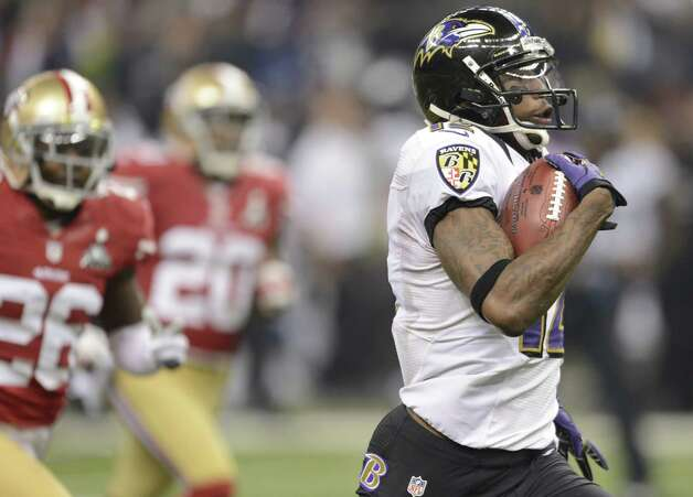 Jacoby Jones (R) of the Baltimore Ravens runs for a touchdown in the third quarter against the San Francisco 49ers during Super Bowl XLVII at the Mercedes-Benz Superdome on February 3, 2013 in New Orleans, Louisiana.  TIMOTHY A. CLARY/AFP/Getty Images Photo: TIMOTHY A. CLARY, Getty Images / AFP