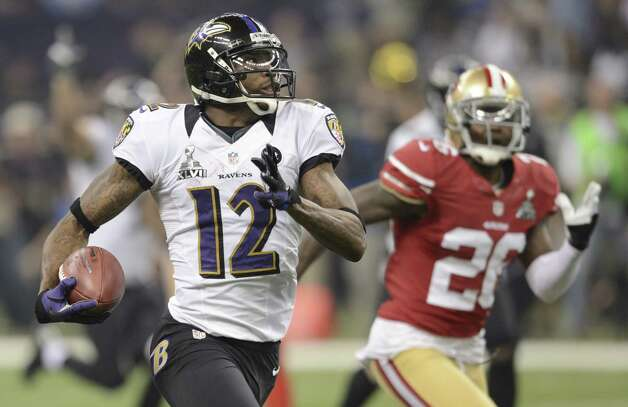 Jacoby Jones (L) of the Baltimore Ravens runs for a touchdown in the third quarter against the San Francisco 49ers during Super Bowl XLVII at the Mercedes-Benz Superdome on February 3, 2013 in New Orleans, Louisiana.  TIMOTHY A. CLARY/AFP/Getty Images Photo: TIMOTHY A. CLARY, Getty Images / AFP