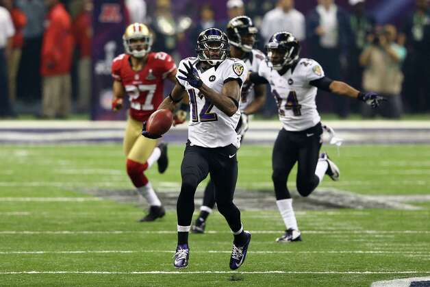 Jacoby Jones #12 of the Baltimore Ravens runs back a record 109-yard kickoff return for a touchdown in the third quarter against the San Francisco 49ers during Super Bowl XLVII at the Mercedes-Benz Superdome on February 3, 2013 in New Orleans, Louisiana.  Al Bello/Getty Images Photo: Al Bello, Getty Images / 2013 Getty Images