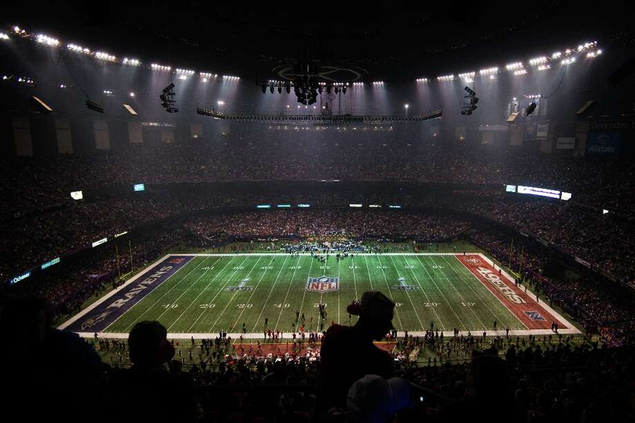 Half of the stadium goes dark as the lights go out on the San Francisco 49ers and Baltimore Ravens during the third quarter of Super Bowl XLVII at the Mercedes-Benz Superdome on Sunday, Feb. 3, 2013, in New Orleans. Photo: Smiley N. Pool, Chronicle / © 2013  Houston Chronicle