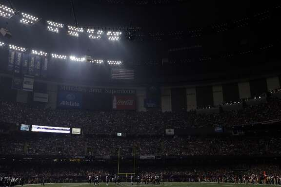 Half the lights are out in the Superdome during a power outage in the second half of the NFL Super Bowl XLVII football game between the San Francisco 49ers and Baltimore Ravens on Sunday, Feb. 3, 2013, in New Orleans.