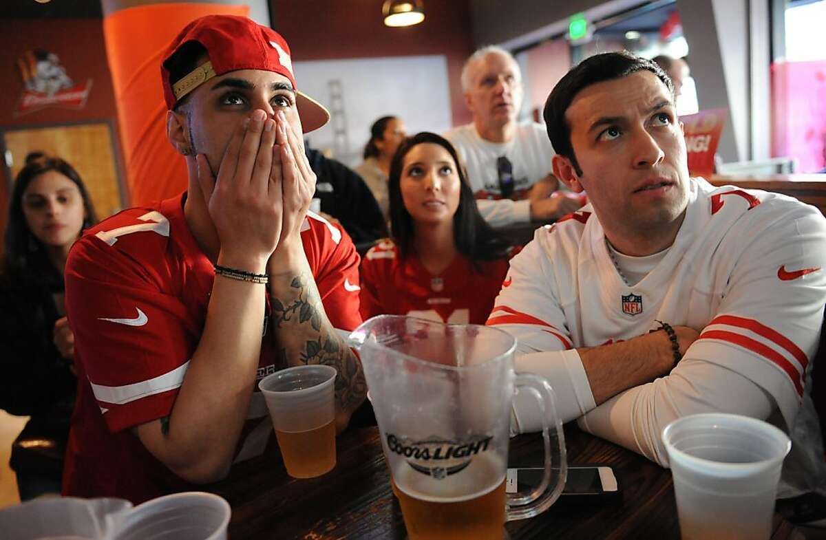From left: Zabi Rahimi, Andrea Cervantes and Ben Urruticochea watch the San Francisco 49ers against the Baltimore Ravens during the Super Bowl at the Cable Car City Pub and Cafe in San Francisco on February 3, 2013.