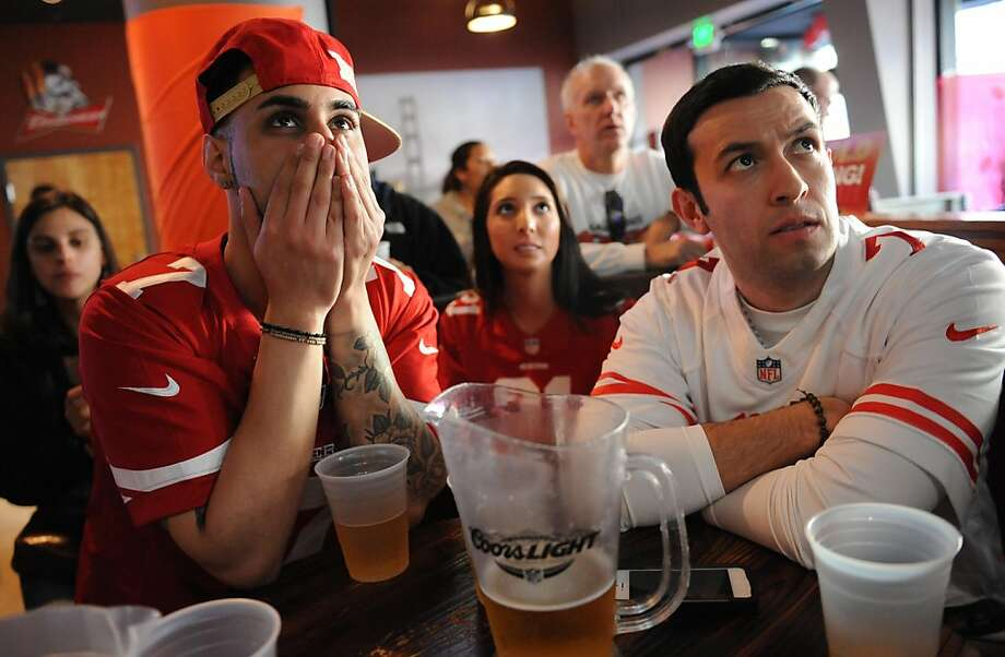 Zabi Rahimi (left), Andrea Cervantes and Ben Urruticochea tensely watch the Super Bowl at the Cable Car City Pub and Cafe in San Francisco. Photo: Susana Bates, Special To The Chronicle