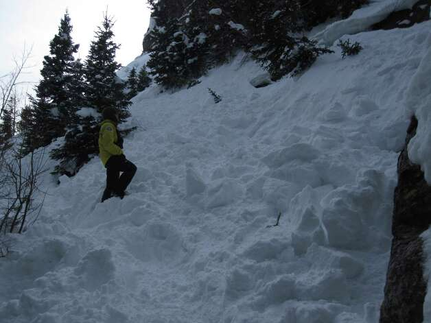 A rescuer searches recent avalanche debris in Rocky Mountain National Park on Sunday, Feb. 3, 2013. A representative for the National Park Service said nothing indicated missing San Antonian Troy Green was in this area. Photo: Courtesy Photo / National Park Service