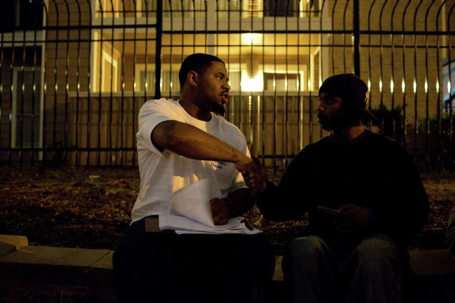 Covenant House volunteer and resident Kennington Adams, left, speaks with Melvin Ceasar as the organization, dedicated to helping homeless youths, takes part in a census of the homeless in Houston. Photo: Eric Kayne / © 2013 Eric Kayne