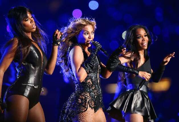 Kelly Rowland, Beyonce Knowles and Michelle Williams of Destinys Child perform during the Pepsi Super Bowl XLVII Halftime Show at Mercedes-Benz Superdome on February 3, 2013 in New Orleans, Louisiana. (Photo by Christopher Polk/Getty Images)
