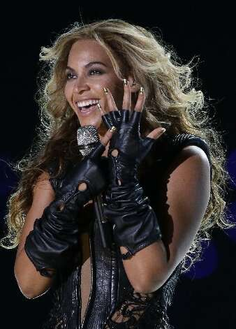 Beyonce performs during the halftime show of NFL Super Bowl XLVII football game between the San Francisco 49ers and the Baltimore Ravens Sunday, Feb. 3, 2013, in New Orleans. (AP Photo/Mark Humphrey)