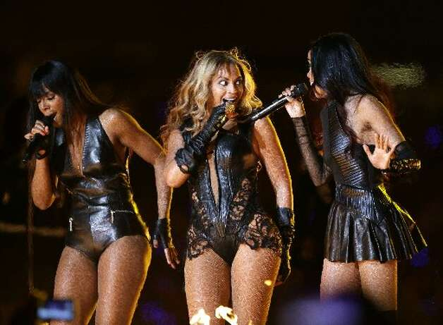 Beyonce, center, Kelly Rowland, left, and Michelle Williams, of Destiny's Child, perform during the halftime show of the NFL Super Bowl XLVII football game between the San Francisco 49ers and the Baltimore Ravens, Sunday, Feb. 3, 2013, in New Orleans. (AP Photo/Mark Humphrey)