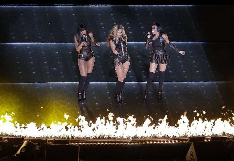 Beyonce performs with Kelly Rowland, left, and Michelle Williams, right, of Destiny's Child, during the halftime show of the NFL Super Bowl XLVII football game between the San Francisco 49ers and the Baltimore Ravens, Sunday, Feb. 3, 2013, in New Orleans. (AP Photo/Charlie Riedel)