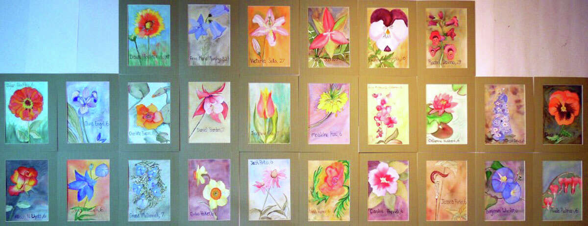 Pamela Hollinde, a substitute art teacher at Greenville Elementary, created 26 watercolor flower paintings as a way to memorialize the victims of Sandy Hook in Newtown, Conn. She sent the paints down to Newtown this this week. (Pamela Hollinde)
