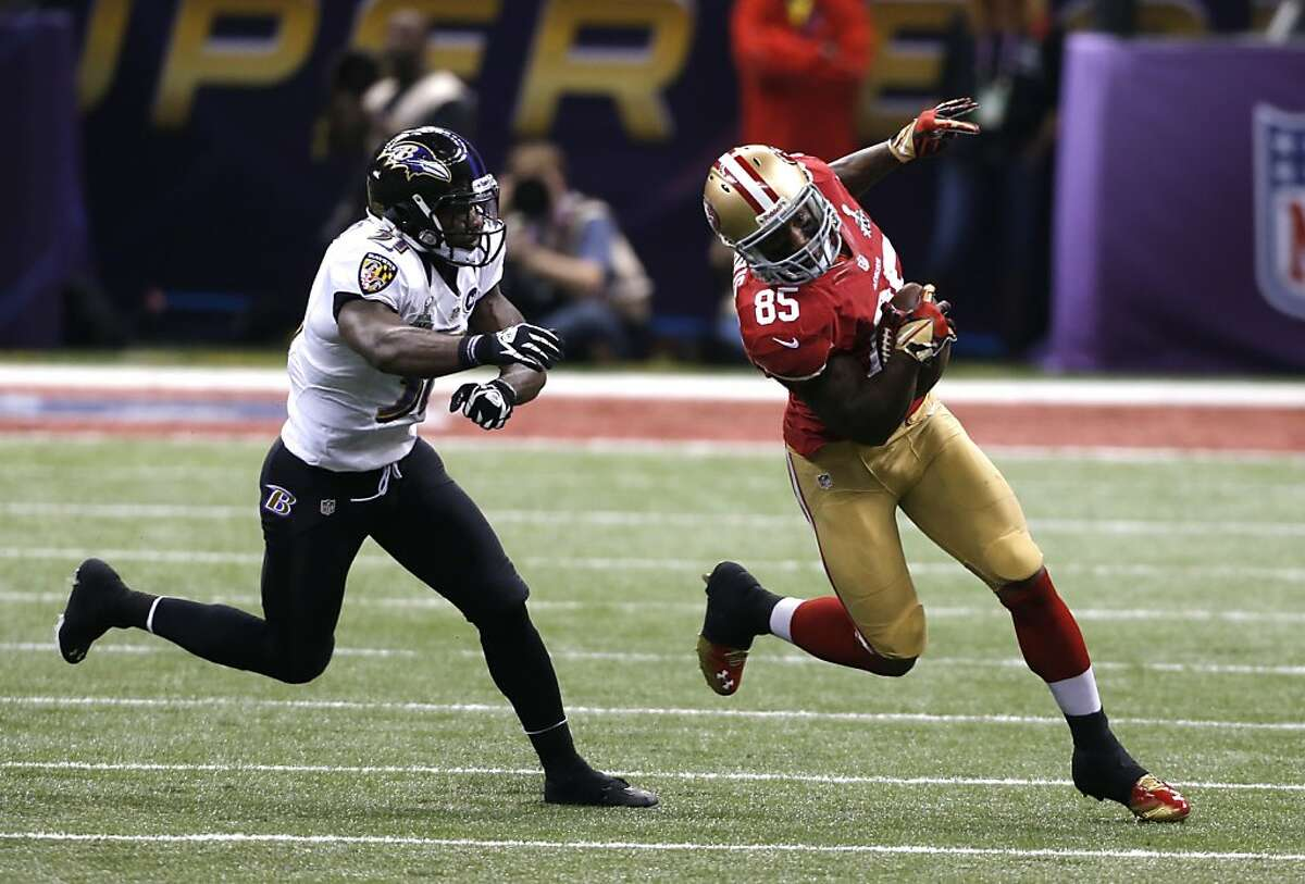 Tight end Vernon Davis (85) takes off downfield past Baltimore Ravens safety Bernard Pollard (31) in the first half of Superbowl XLVII between the San Francisco 49ers and the Baltimore Ravens at the Mercedes-Benz Superdome on Sunday February 3, 2013 in New Orleans, La.