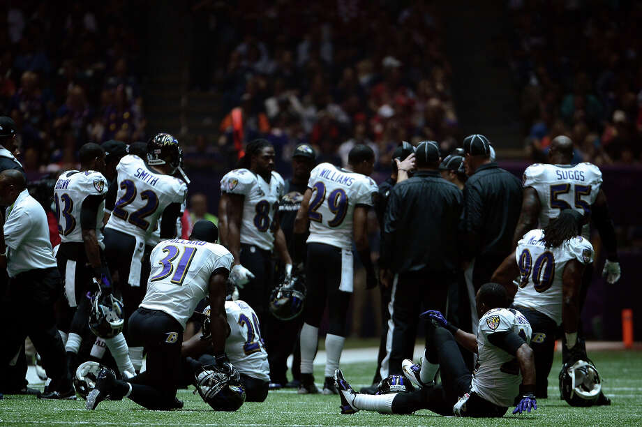 NEW ORLEANS, LA - FEBRUARY 03:  The Baltimore Ravens sit on the field after a sudden power outage in the second half during Super Bowl XLVII at the Mercedes-Benz Superdome on February 3, 2013 in New Orleans, Louisiana. Photo: Harry How, Getty Images / 2013 Getty Images