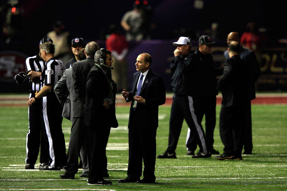 NEW ORLEANS, LA - FEBRUARY 03:  Officials stand on the field at the Mercedes-Benz Superdome after a sudden power outage that lasted 34 minutes in the second half during Super Bowl XLVII between the Baltimore Ravens and the San Francisco 49ers at the Mercedes-Benz Superdome on February 3, 2013 in New Orleans, Louisiana. Photo: Jamie Squire, Getty Images / 2013 Getty Images