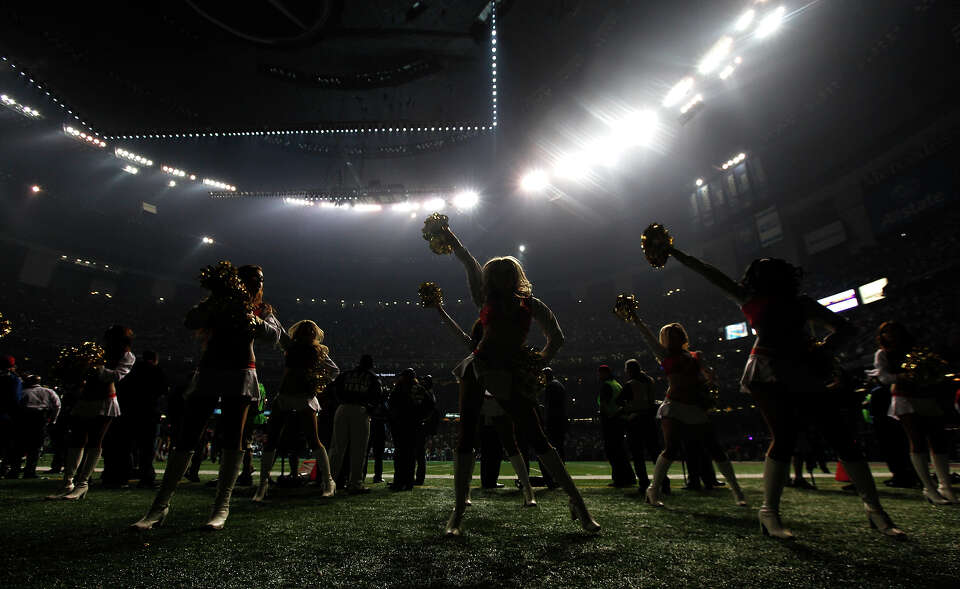 San Francisco 49ers cheerleaders perform during a power outage at the Superdome in the second half o