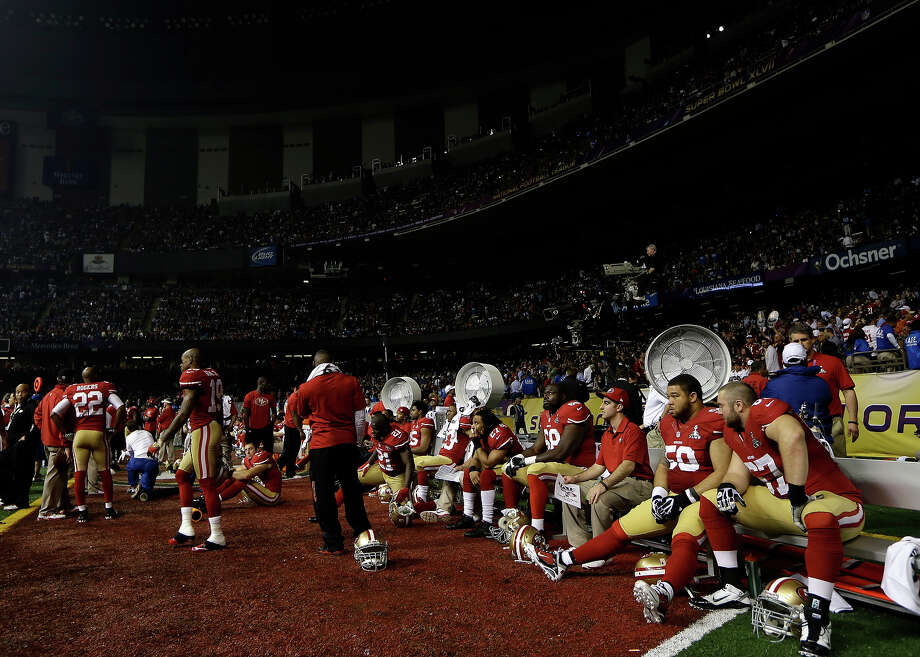The San Francisco 49ers sit on the bench during a power outage in the second half of the NFL Super Bowl XLVII football game against the Baltimore Ravens, Sunday, Feb. 3, 2013, in New Orleans. (AP Photo/Matt Slocum) Photo: Matt Slocum, ASSOCIATED PRESS / AP2013