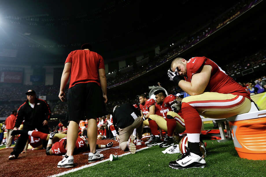 San Francisco 49ers offensive lineman Daniel Kilgore, right, sits on the sidelines during a power outage in the second half of the NFL Super Bowl XLVII football game against the Baltimore Ravens, Sunday, Feb. 3, 2013, in New Orleans. (AP Photo/Marcio Sanchez) Photo: Marcio Sanchez, ASSOCIATED PRESS / AP2013