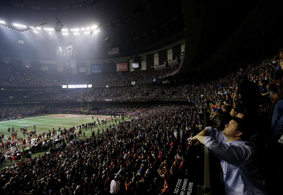 Fans and members of the Baltimore Ravens and the San Francisco 49ers wait for power to return in the Superdome during an outage in the second half of the NFL Super Bowl XLVII football game, Sunday, Feb. 3, 2013, in New Orleans. Photo: Gerald Herbert, AP / AP