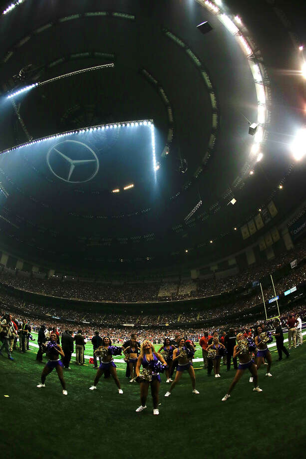 The Baltimore Ravens cheerleaders stand on the field during a power outage in the second half of the NFL Super Bowl XLVII football game between the San Francisco 49ers and the Baltimore Ravens Sunday, Feb. 3, 2013, in New Orleans. Photo: Julio Cortez, AP / AP