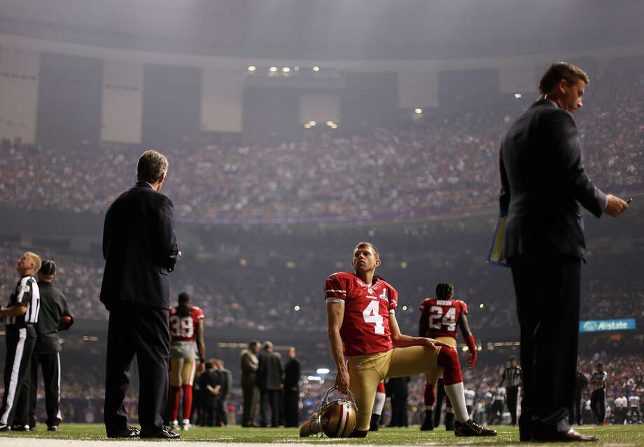 San Francisco 49ers punter Andy Lee (4) looks on during a power outage in the second half of the NFL Super Bowl XLVII football game against the Baltimore Ravens, Sunday, Feb. 3, 2013, in New Orleans. (AP Photo/David Goldman) Photo: David Goldman, ASSOCIATED PRESS / AP2013