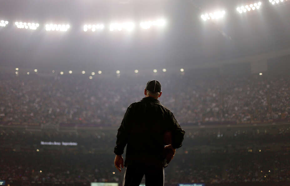 An official looks on during a Superdome power outage in the second half of the NFL Super Bowl XLVII