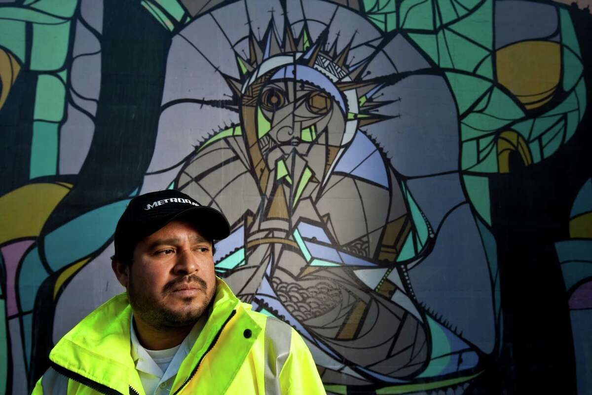 Houston mural artist Daniel Anguilu says he starts with circles when he makes a mural. Among his final touches are thick, spray-painted lines that give the mural a stained-glass look. Anguilus first used paint in his teen years, on buildings and rail cars.
