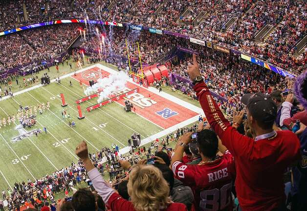 Niners fans cheer their team's entrance at the Superdome, but it would be a while before the game provided further cheer for the San Francisco contingent, whose team soon faced a 28-6 deficit. Photo: Smiley N. Pool, Chronicle