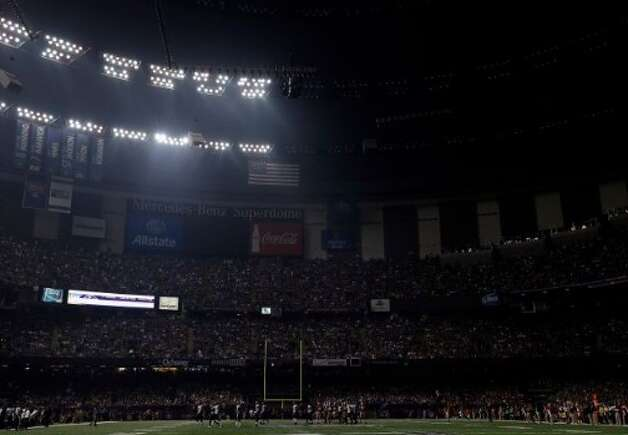 A fan takes pictures of the Superdome after the lights went out during the second half of NFL Super Bowl XLVII football game Beyonce performs during the halftime show of Sunday, Feb. 3, 2013, in New Orleans. (AP Photo/Gene Puskar)